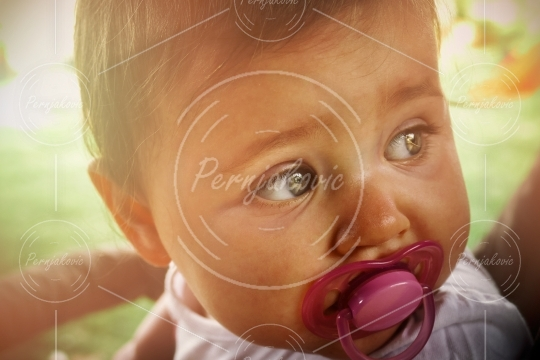 Baby with pink pacifier portrait