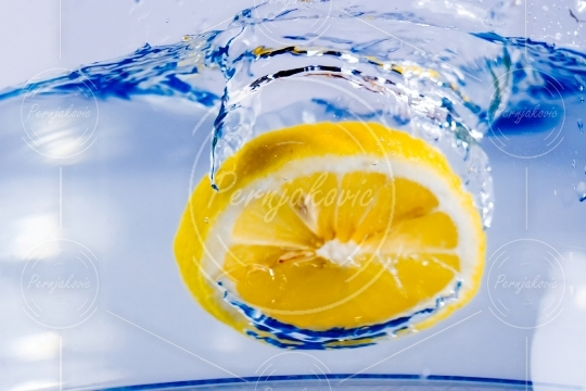 Lemon falling in water