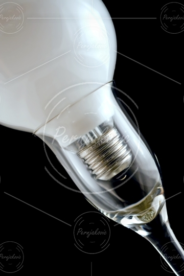 Light bulb in a glass of wine